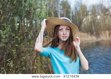 Freckled Girl In Hat On The Lake