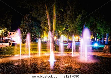 Small Fountain In The City Park On A Summer Night
