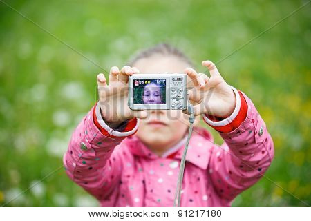 Little Girl Making A Selfie With Digital Camera