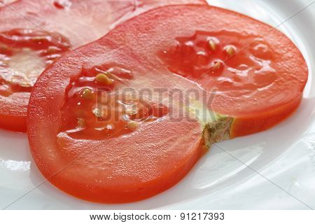 Sliced Tomato On White Plate