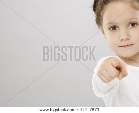 Five years girl pointing with finger