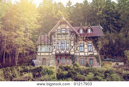 traditional half-timbered villa in the woods