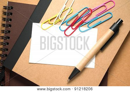 White Blank Card With Paper Clips And Pen
