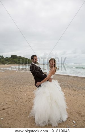Happy And Lovely Wedding Couple Holding Each Other With Tenderness