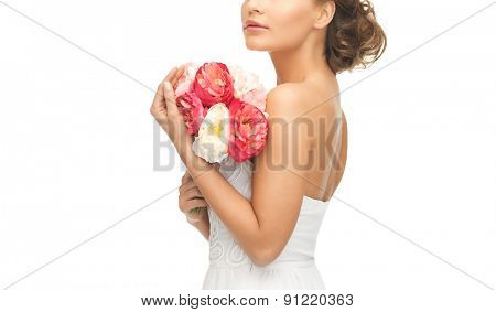 picture of young woman with bouquet of flowers.