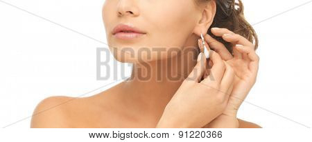 close-up of beautiful woman wearing shiny diamond earrings