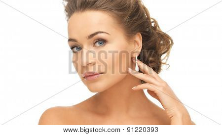 beautiful woman in white dress and diamond earrings