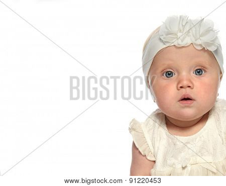 baby girl child  white dress fashion portrait face studio shot isolated on white caucasian looking at camera