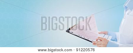 healthcare, cardiology, people and medicine concept - close up of female holding clipboard with cardiogram