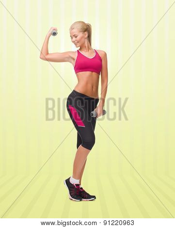 sport, fitness, training, weightlifting and people concept - young sporty woman with dumbbells flexing biceps over yellow striped background