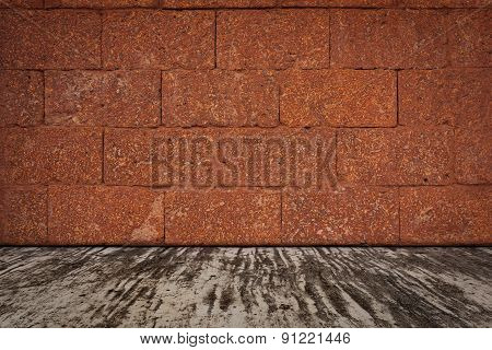 Laterite Stone Wall And A Cement Floor.