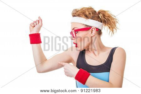 Funny Fitness Woman Pointing On Her Biceps, Isolate On White