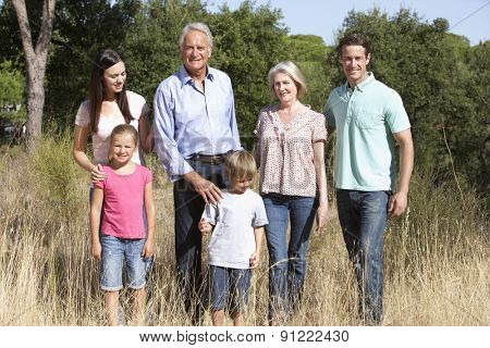 Extended Family Walking Through Summer Countryside