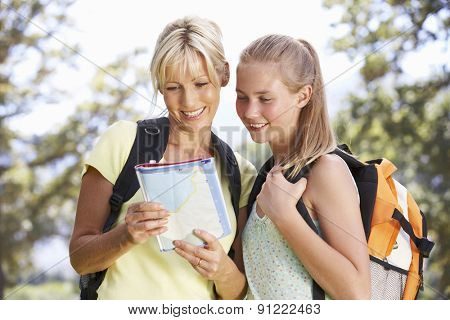 Mother And Daughter Hiking Through Countryside
