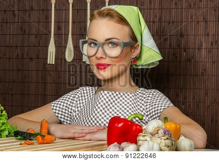Close-up Portrait Of A Rural Woman Cook With Vegetable