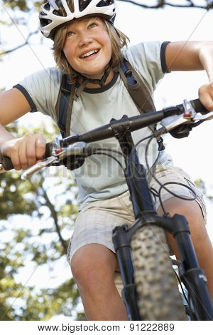 Teenage Boy Cycling Through Countryside