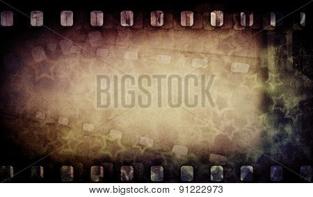 Grunge old film strip with stars. Vintage background