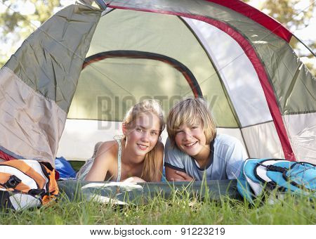 Teenage Couple On Camping Holiday In Countryside
