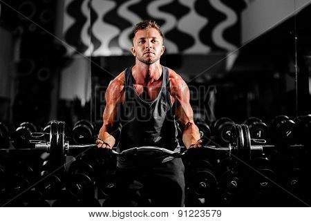 Handsome Muscular Motivated  Man Workout Weightlifting In Gym