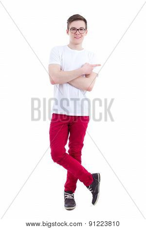 Young Handsome Man In White T-shirt Pointing At Something Isolated On White