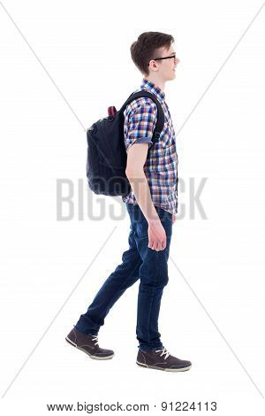 Handsome Teenage Boy With Backpack Walking Isolated On White