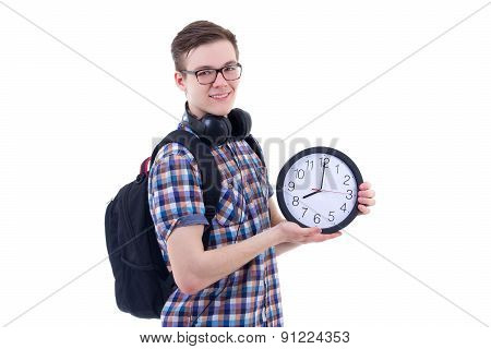 Portrait Of Handsome Teenage Boy With Backpack And Office Clock Isolated On White