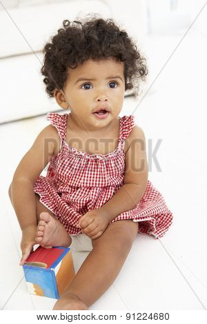 Young Girl Playing With Wooden Building Blocks