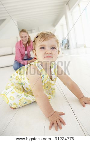 Mother and Daughter Pplaying Together At Home