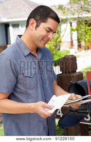 Hispanic Man Checking Mailbox