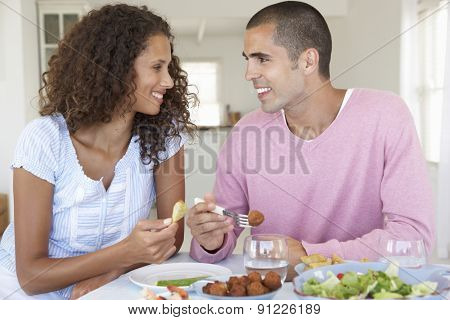 Young Couple Enjoying Meal At Home