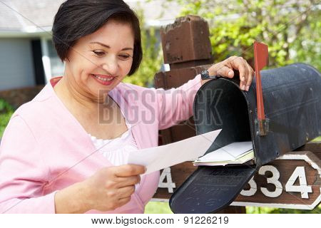 Senior Hispanic Woman Checking Mailbox