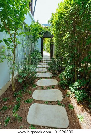 Rocks Pathway Through A Tropical Country House.