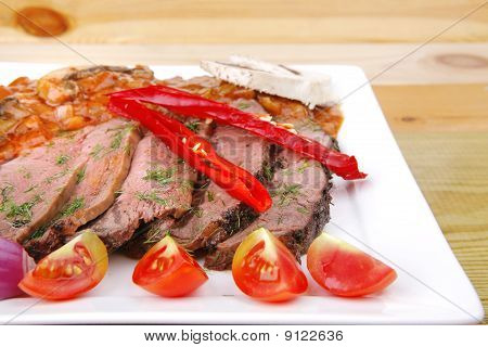 Beef On Plate Over Wood