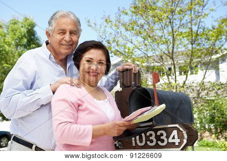 Senior Hispanic Couple Checking Mailbox