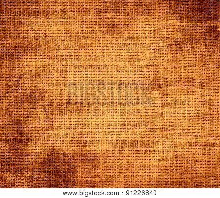 Grunge background of cadmium orange burlap texture