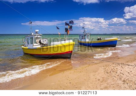 Fishing boats on the beach of Baltic Sea in Poland