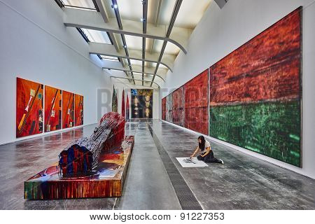 Beijing , China - September 23, 2014 : student painting inside the UCCA in the  798 Art District zone aera in Beijing China