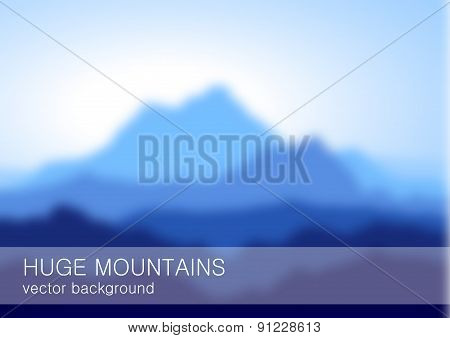 Blurred lanscape with high blue mountains