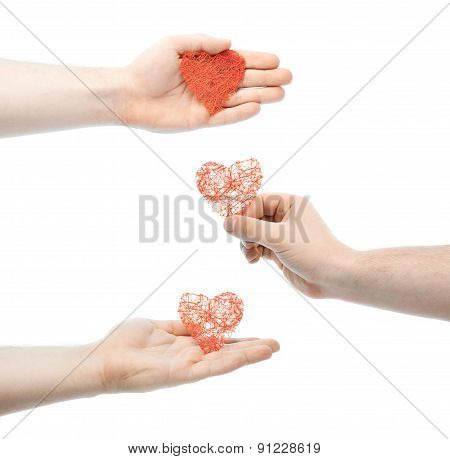 Caucasian male hand holding a heart