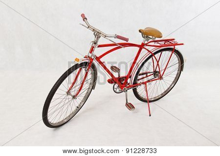 Antique red bike on white background