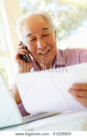 Senior Taiwanese man working at home