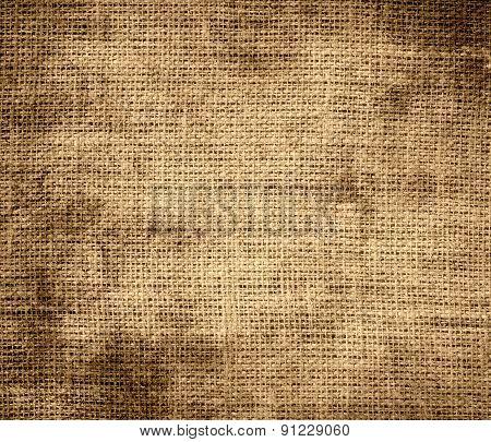 Grunge background of camel burlap texture