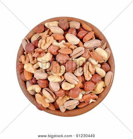 Assorted Nuts In A Wooden Bowl On A White Background