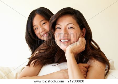 Portrait Asian mother and daughter