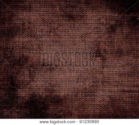 Grunge background of caput mortuum burlap texture