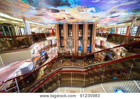 Cruise ship's main lobby with different shops and bars around.