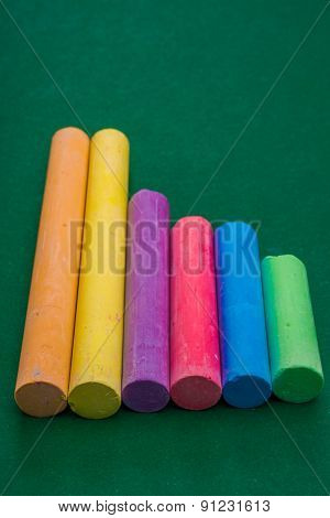 Six Pieces Of Chalk On Green