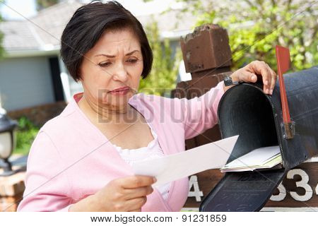 Worried Senior Hispanic Woman Checking Mailbox