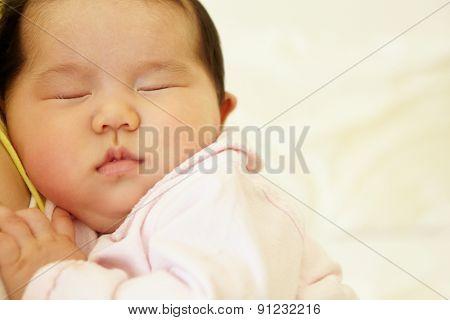Vietnamese mother cuddling baby