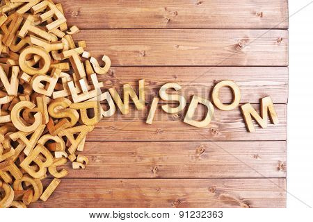 Word wisdom made with wooden letters